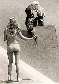 Jarno Saarinen (1945 - 1973) with wife Soili giving pit signals.