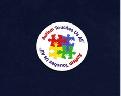 Round Autism Touches Us All Button Pins. Each pin is approximately 2 inches in diameter. Packaged 25 pins per pack. Product Code: P-20-2