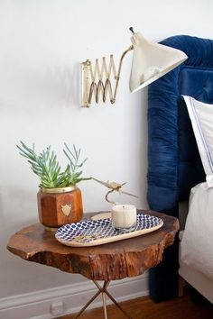 Bedside table. Tree trunk. Furniture. Bedroom. Blue headboard. Bed. Decor. Home.