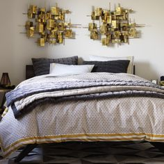 Folded Brass Wall Decor | Layer this brass sculpture into your gallery wall for a burst of metallic glam, or let it stand alone to spotlight its artistic and sculptural design.