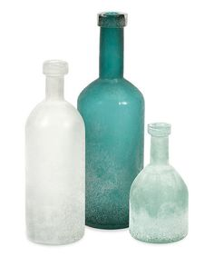 The IMAX Russell Handblown Glass Bottles - Set 3 includes three hand-blown glass bottles. Each boasts a frosted finish in rich shades of either aqua,. Blue Glass Bottles, Bottle Vase, Frosted Glass, Sea Glass, Decorative Objects, Decorative Bowls, Decorative Accents, Pots, Hand Blown Glass