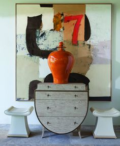 orange urn and abstract art