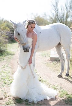 This just confirms it, every bride needs a horse! Captured by Stephanie Fay Photography http://www.stephaniefay.com/blog.cfm?catID=2&postID=475&four-seasons-scottsdale-wedding