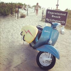 Vespa with surfboard rack