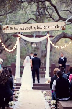 Love the wedding sign they walk under!