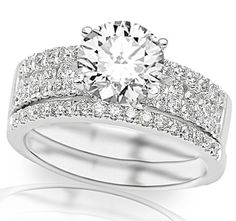 2.08 Carat Platinum Three Row Prong And Middle Row Channel Set Round Diamonds Engagement Ring and Wedding Band Set with a 1.5 Carat Moissanite Center