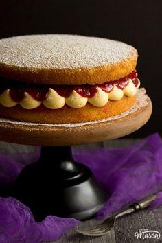 Rhubarb and custard cake on a cake stand Rhubarb And Custard, Rhubarb Cake, Custard Cake, Victoria Sandwich Cake, British Baking Show Recipes, Victoria Cakes, Cold Cake, Baked Cheesecake Recipe, Baking Tins