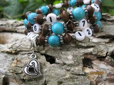 Breastfeeding Reminder Nursing Helper Bracelet. It's hard to keep up and remember the last time your little one nursed or which breast he nursed from. The nursing reminder bracelet keeps track for you. You simply move the clasp and charm to the time you start nursing and wear it on the wrist corresponding with the breast which they are nursing. The beautiful turquoise colored stone and brown wood beads represent 15 min increments.