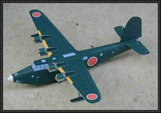 This airplane paper model is a Kawanishi (Type 2 Large-sized Flying Boat), an Imperial Japanese Navy (IJN) flying boat used during World War II for mar Paper Airplane Models, Model Airplanes, Paper Models, Brewster Buffalo, Papercraft Download, Imperial Japanese Navy, Flying Boat, Kirigami, Wwii