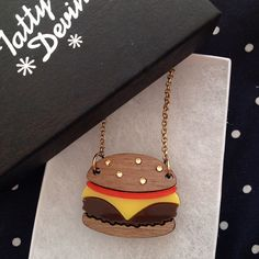 Yum, yum! Celebrate #NationalBurgerDay with our walnut wood and Perspex Cheeseburger Necklace: http://www.tattydevine.com/cheeseburger-necklace.html