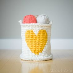 Make this sweet heart basket by All About Ami with Lion Brand Hometown USA! Free fair-isle crochet pattern!