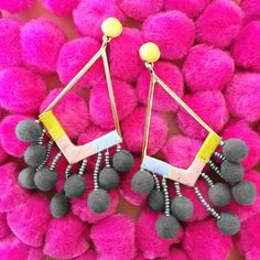 Getting into the pom-pom trend, especially with these earrings.
