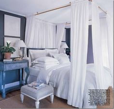 love the wall color and the bed ooooh the bed.... I wonder if I could talk Steve into this :)