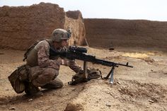 A machine gunner with Bravo Company, 1st Battalion, 7th Marine Regiment, provides security with his M240B medium machine gun during a mission in Helmand province, Afghanistan, May 15, 2014.