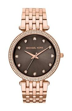 I love the darker face with the lighter gold band on this watch