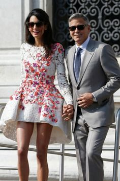 #FashionInspiration... If THIS is what Amal Alamuddin picked to wear for her first post wedding event, I can only imagine how spectacular her actual wedding dress was! On route to brunch with family and friends, Amal stepped out in a Giambattista Valli couture long-sleeved mini dress, with a rise and fall hemline. Love it or leave it?