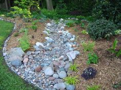 how to make a dry creek bed | Several years ago I built a dry creek bed in my backyard.