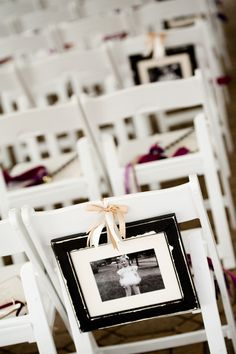 Versiering aan de stoelen met persoonlijke foto van het bruidspaar. Leuk idee voor #bruiloft #wedspiration Childhood Photos Lined The Aisle Chairs with the Wedding Wands