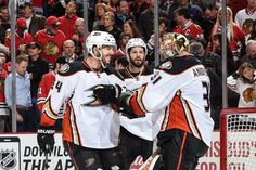 Simon Despres #24 and Ryan Kesler #17 of the Anaheim Ducks celebrate with goalie Frederik Andersen #31 after defeating the Chicago Blackhawks 2-1 in Game Three of the Western Conference Finals