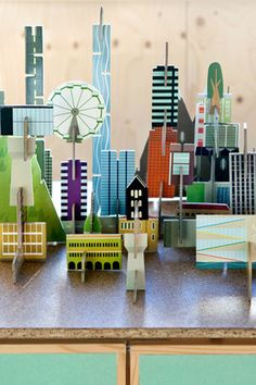 Archiville cardboard city with houses, mountains, skyscrapers, trees and roads. By Dutch co Kidsonroof