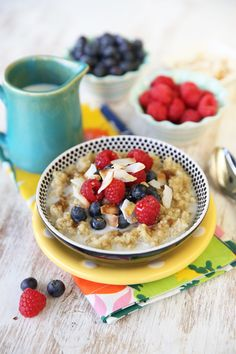 Delicious and wholesome Coconut and Berry Topped Sweet Breakfast Quinoa.  Protein and fiber packed = the perfect morning meal!