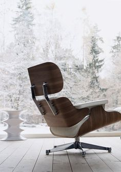 Via Vitra | Eames Lounge Chair--love the white leather with the medium tone wood