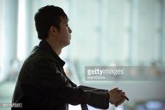 ストックフォト : Young businessman standing in the office