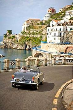 Drive along the Amalfi Coast in a vintage open top car!