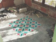Javier De Riba spray paints floors of derelict buildngs in geometric patterns