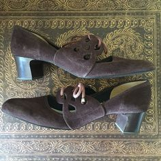 Vintage shoes Brown suede with cutouts. Excellent vintage condition. No stains, scuffs, etc. Look like may have been worn once. Size 8.5 AA, but do not look super narrow IMO. Vintage Shoes