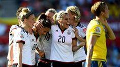 Dzsenifer Marozsan of Germany celebrates with Lena Goessling