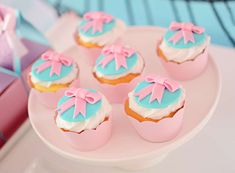 Loving the cupcakes at this The cookies at this LOL Surprise Dolls Birthday Party! The pink fondant bows are so cute! See more party ideas and share yours at CatchMyParty.com  #catchmyparty #partyideas #lolsurprisedollsparty #lolsurprisedolls  #girlbirthdayparty #lolsurprisedollcupcakes