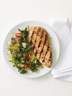 Grilled Chicken with Roasted Kale : Roasting kale creates a crispy texture that pairs perfectly with simply grilled chicken. Fresh lemon juice adds a dose of freshness to this easy, healthy dish.