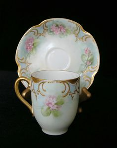 4:00 Tea...Haviland Limoges...delicate robin's egg blue with tiny pink flowers and gold gilt...Marked 12 which dates it 1894 to 1931.