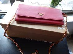 Prada Woc Wallet On Chain Pink Cross Body Bag https://www.tradesy.com/bags/prada-cross-body-bag-2066237/?tref=closet