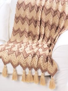 Ripple Beige Afghan | Crochet Patterns | Yarnspirations. //  I LOVE WHEN THEY BREAK UP A RIPPLE PATTERN WITH SOMETHING COMPLETELY DIFFERENT! SUCH A HANDSOME AFGHAN!  ♥A