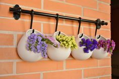 Repurpose your coat hanger into vase wall decor for a vintage look. // Terrace flowers