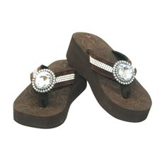Wedge flip flop with large rhinestone.