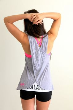 Blogilates Criss Cross Drapery Back Top in grey $24 http://www.ogorgeous.com/product/criss-cross-drapey-back-top