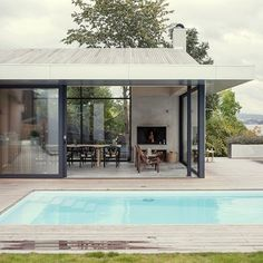 Oslo-based architecture office Skapa has transformed a tired villa near the Norwegian capital into a contemporary home featuring full-height glazed walls that open up to views of the surrounding trees and seascape. More images and info at dezeen.com/tag/norway #architecture #house #swimmingpool #norway - Architecture and Home Decor - Bedroom - Bathroom - Kitchen And Living Room Interior Design Decorating Ideas - #architecture #design #interiordesign #homedesign #architect #architectural…