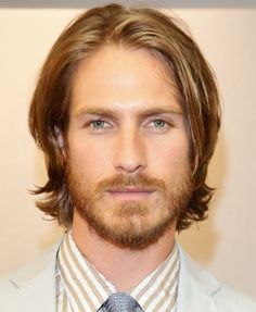 Hottie - even with the long hair.   Long hair styles for men..