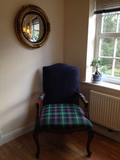 A commissioned Parisian Armchair upholstered in traditional Sutherland tartan.