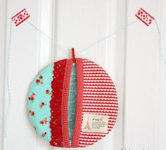 Fat Quarter Pot Holder -  Do-it-yourself home decorating should do more than just spruce up your lifestyle. True, projects like this Fat Quarter Pot Holder look great, but they also provide an essential service in your kitchen. Learning how to make potholders like this one involves batting, patchwork, and of course, fat quarters. Once you've conquered your first Fat Quarter Pot Holder, make another for a friend or neighbor.