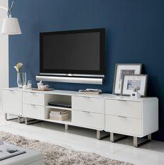 Deep blue wall, modern & simple white tv set, deep blue & white decor