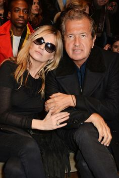 Kate Moss and Mario Testino Front Row at Burberry Prorsum [Photo by David M. Benett / Getty]