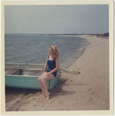 Kodacolor-elegant-shot-of-red-haired-beach-gal-sitting-on-edge-of-boat-1960s