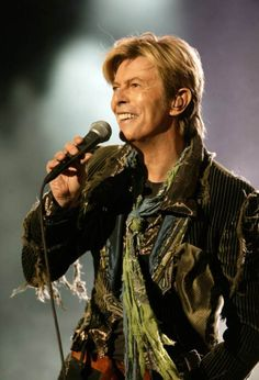 "NEWPORT, UNITED KINGDOM - JUNE 13: Singer David Bowie performs on stage on the third and final day of ""The Nokia Isle of Wight Festival 2004"" at Seaclose Park on June 13, 2004 in Newport, Isle of Wight, UK. The third annual rock festival takes place during the Isle of Wight Festival which runs from June 4-19. (Photo by Dave Hogan/Getty Images)"