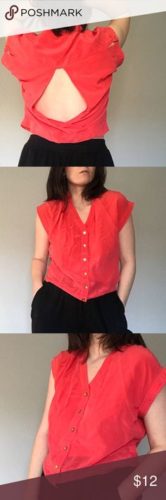 B E B E | Silk Cut Out Blouse B E B E | Silk Salmon Cut Out Top  100% Silk short sleeve button down. V neck with gold buttons down front and on sleeves. Great cut out in back.  Length: 21 Pit to pit: 18 Brand: bebe  Condition: Like New bebe Tops