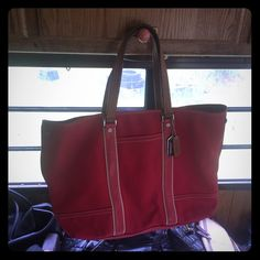 Authentic coach bag large. Authentic large red handbag. Beautiful no flaws that I can see.  I've had the bag for a year and a half I bought it from my mother and I have no idea when she got it. Lol. Coach Bags