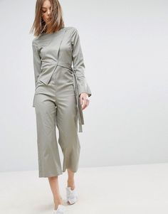 Get this Asos's long jumpsuit now! Click for more details. Worldwide shipping. ASOS Jumpsuit in Cotton Shirting - Green: Jumpsuit by ASOS Collection, Stretch cotton, Round neck, Asymmetric wrap-over detail, Split cuffs, Zip-back fastening, Straight cropped leg, Regular fit - true to size, Machine wash, 97% Cotton, 3% Elastane, Our model wears a UK 8/EU 36/US 4 and is 178cm/5'10 tall. Score a wardrobe win no matter the dress code with our ASOS Collection own-label collection. From polished…